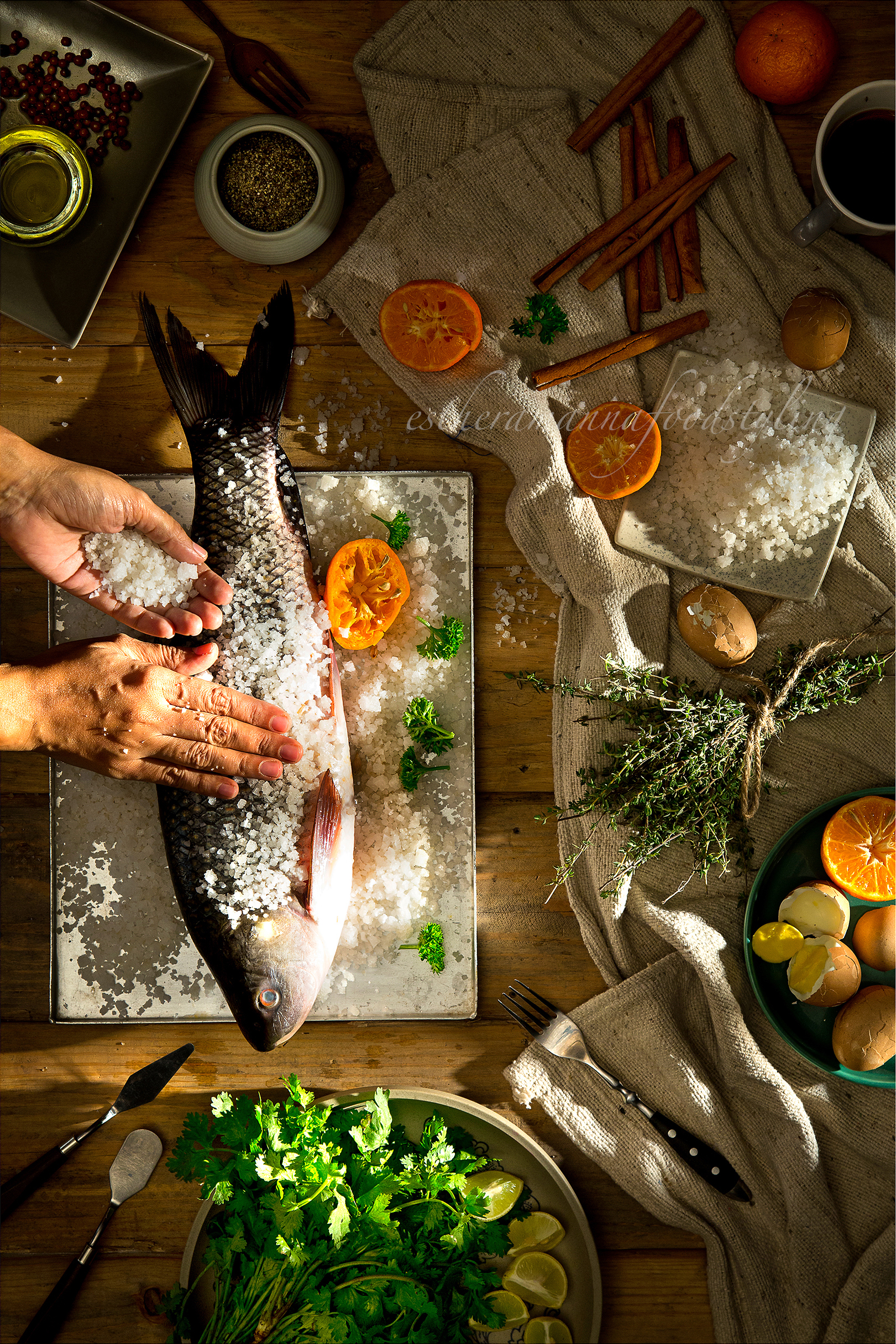 A lifestyle image with fish being prepared for supper.Hands play an integral part in Food.